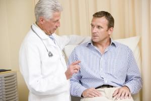 bigstock-Doctor-Giving-Man-Checkup-In-E-4137096-300x200
